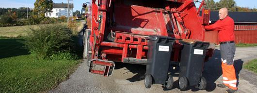 Lastebil, søppeldunker, en mann