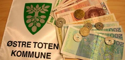 Østre Toten kommunes kommunevåpen, mynter og pengesedler