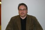 Leder John Hage