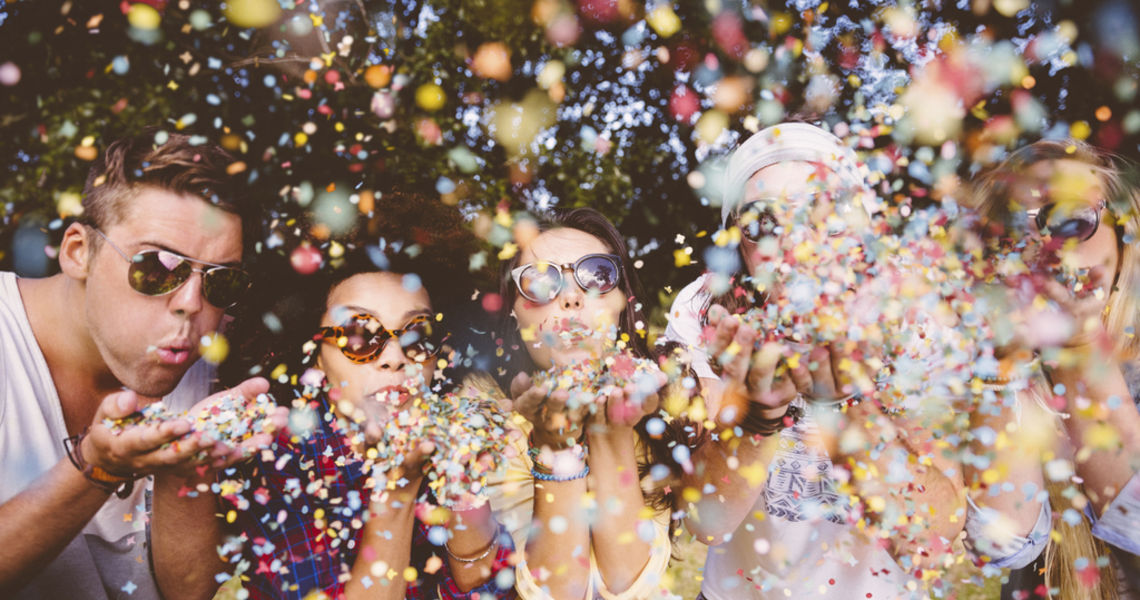 Hipsters blowing confetti