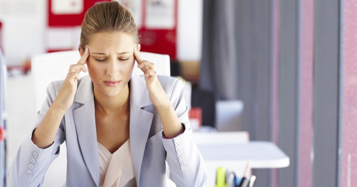 Businesswoman With a Headache