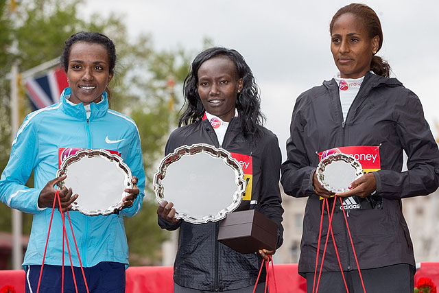 Tirunesh Dibaba ETH (second) Mary Keitany KEN (winner) and Aselefech Mergia ETH on the podium after the Elite Women's Race. The Virgin Money London Marathon, 23rd April 2017.