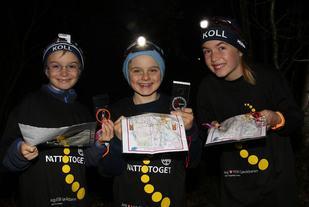Ole Jacob Myklebust (8 år), August Myklesbust Leopolder (8) og Pauline Myklebust (12), som alle er fra Kringsjå, gleder seg til Trollnatta.