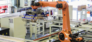 Industrial picking robot in production line manufacturer factory