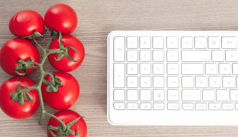 Online Personal Fitness Training and dieting - Bunch of Tomatoes next to keyboard
