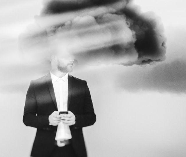 Businessman brainstorming, cloud computing.