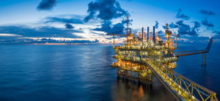 Panorama of Oil and Gas central processing platform in twilight,