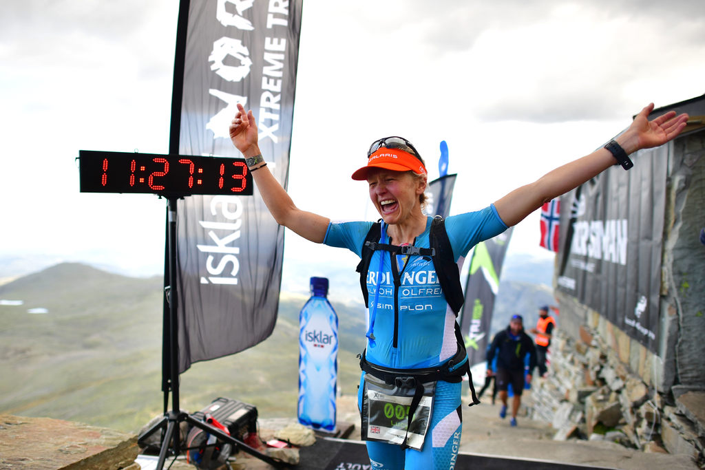 Lucy Gossage of Great Britain finishes first and wins the Xtri World Tour during the Isklar Norseman Xtreme Triathlon on August, 03, 2019 in Eidfjord, Norway. 250 athletes participate in the Isklar Norseman Xtreme Triathlon 2019 which includes 3.8 kilomet