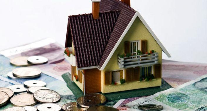 Bilde av penger og eiendom i forbindelse med eiendomskatt