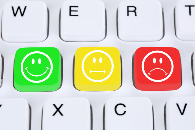 Choosing customer service quality with smiley on computer keyboa