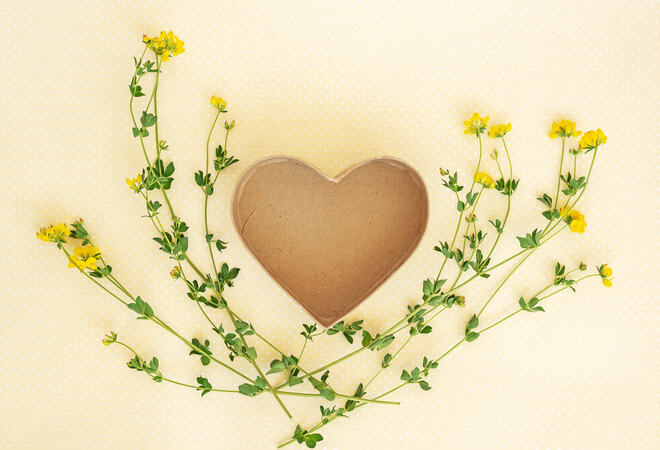 Creative layout made of flowers and leaves with heart shaped gif